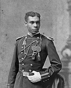 Black and white photo of an African American Soldier posed in his West Point uniform.