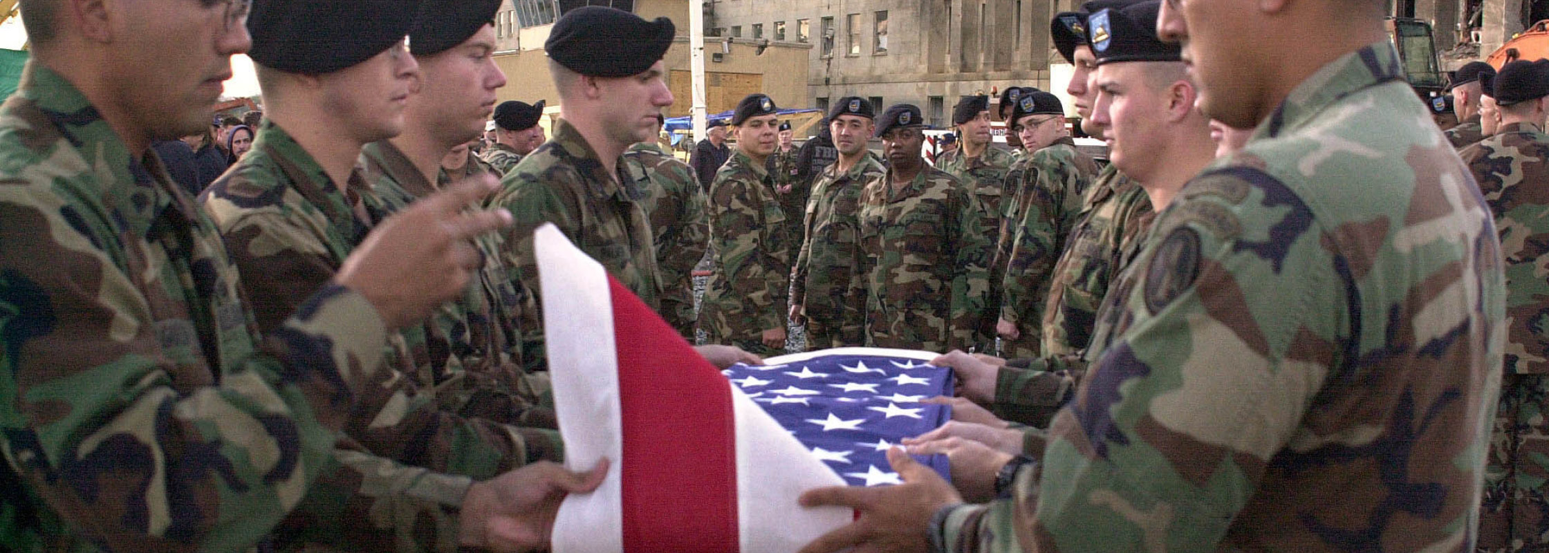 Image of American Soldiers Folding the American Flag During a 9/11 Ceremony